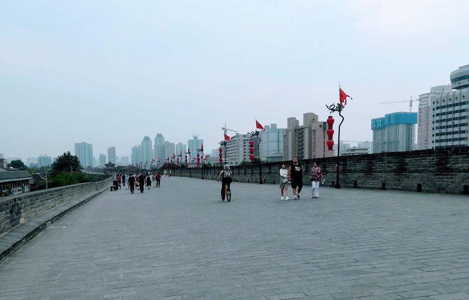 Cycling around the city wall Xian China min 1