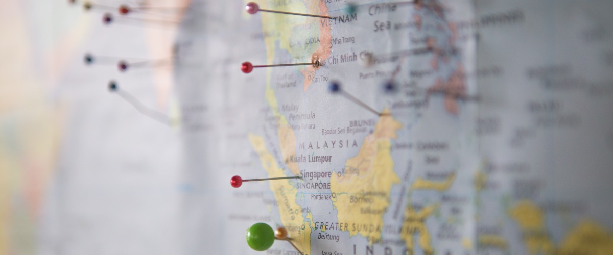 Image of map with location pins in it - one of the top travel resources for travel planningResources for Travel
