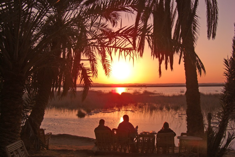 Siwa Oasis at sunrise - one of the best times to visit the Lake Siwa.One of the must-see Egypt tourist attractions in Siwa Oasis
