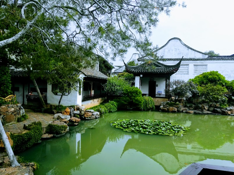 First of the Suzhou garden photos shows a Chinese building reflected a serene green pool