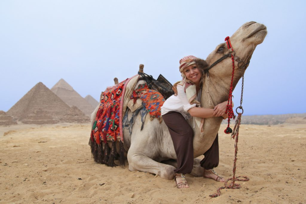 Image of woamn traveling in Egypt wearing culturally appropriate clothes