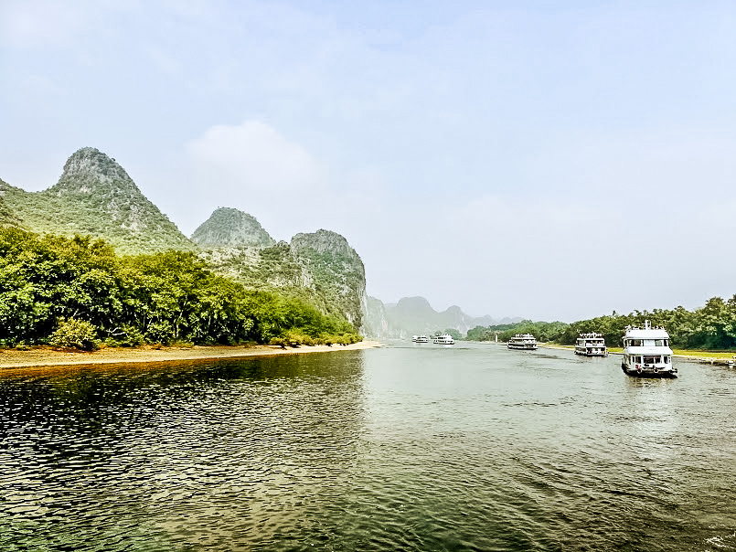 A river cruise in Guilin passes through magical rock formations called Karst peaks