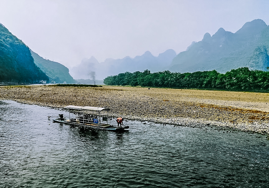 When you take a cruise on the Li River in China, look out for traditional fishermen, using a tethered cormorant