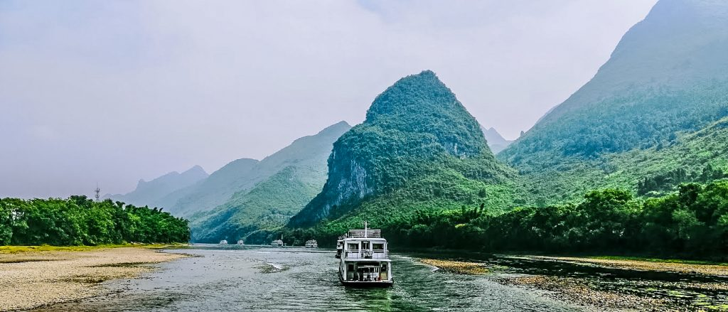Taking a river cruise in Guilin is a very pleasant way to travel down the Li River to Yangshuo