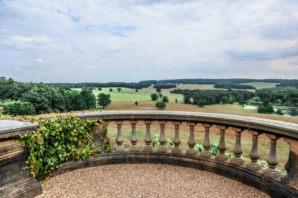 Visiting Harewood House - A Grand Yorkshire Day Out - Grey Globetrotters. The view from the terrace across the gardens down to the lake