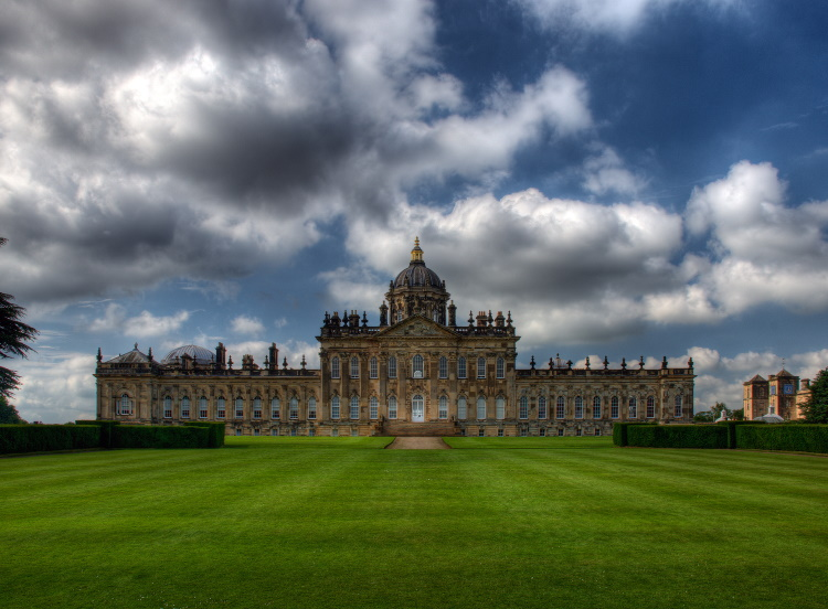 Exterior photo of Castle Howard, North Yorkshire, one of Britains's most magnificent stately homes, viewed from the extensive gardens.