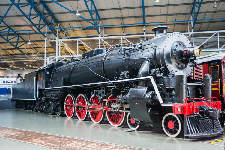 Large black and red steam train on display at the free National Railway Museum in York