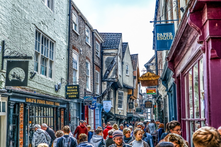 Medieval street called the Shambles in York, packed with tourists