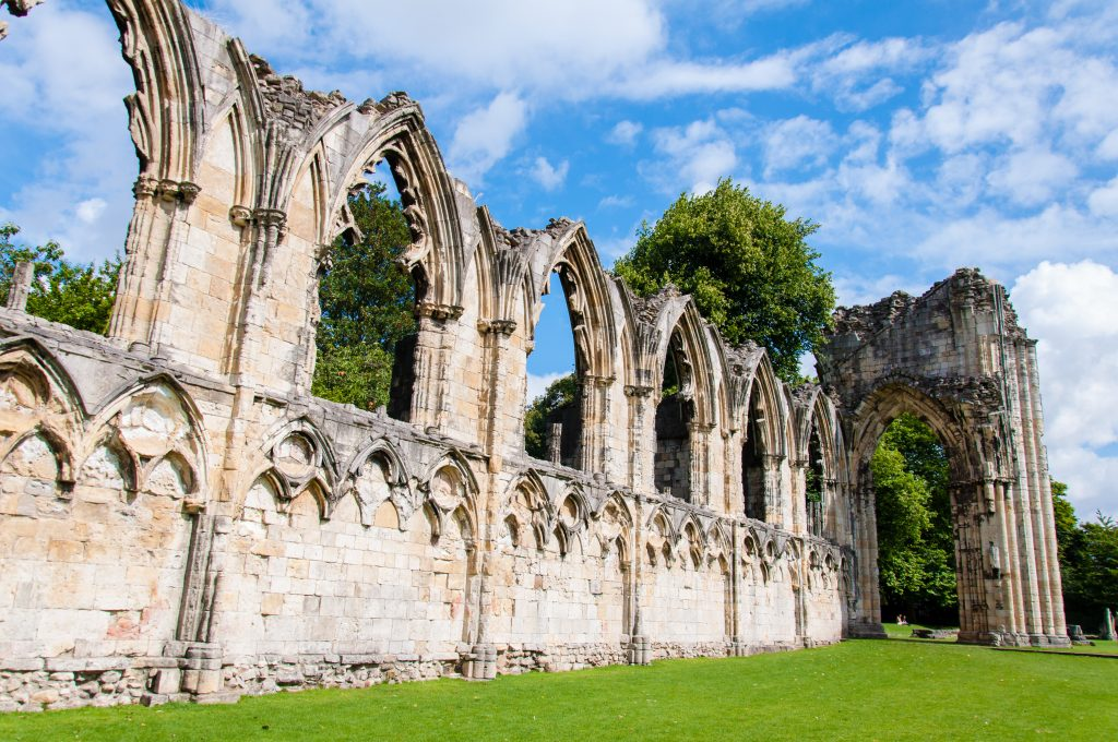 The ruins of St Mary's Abbey, York. Wall with catherdral arched windows.