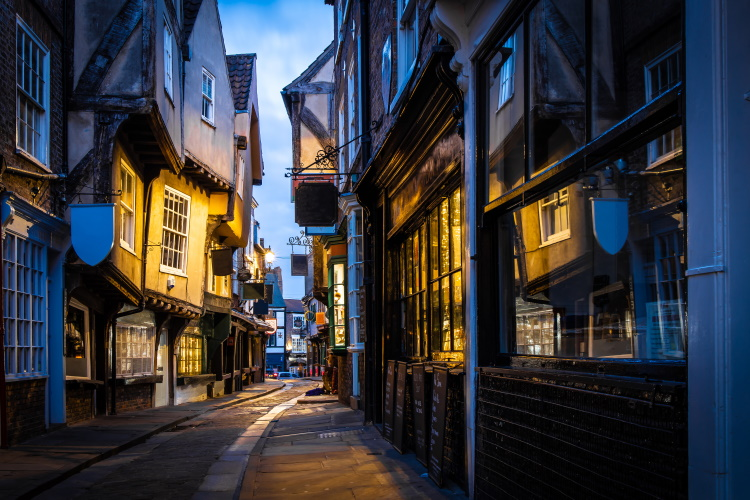 Narrow, cobbled, medieval street called the Shambles - one of the highlights of a weekend in York for any visitor