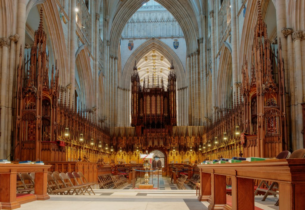 View of the choir stalls towards the organ at York Minster, UK. One of the top things to do in York at night is to attend evensong here