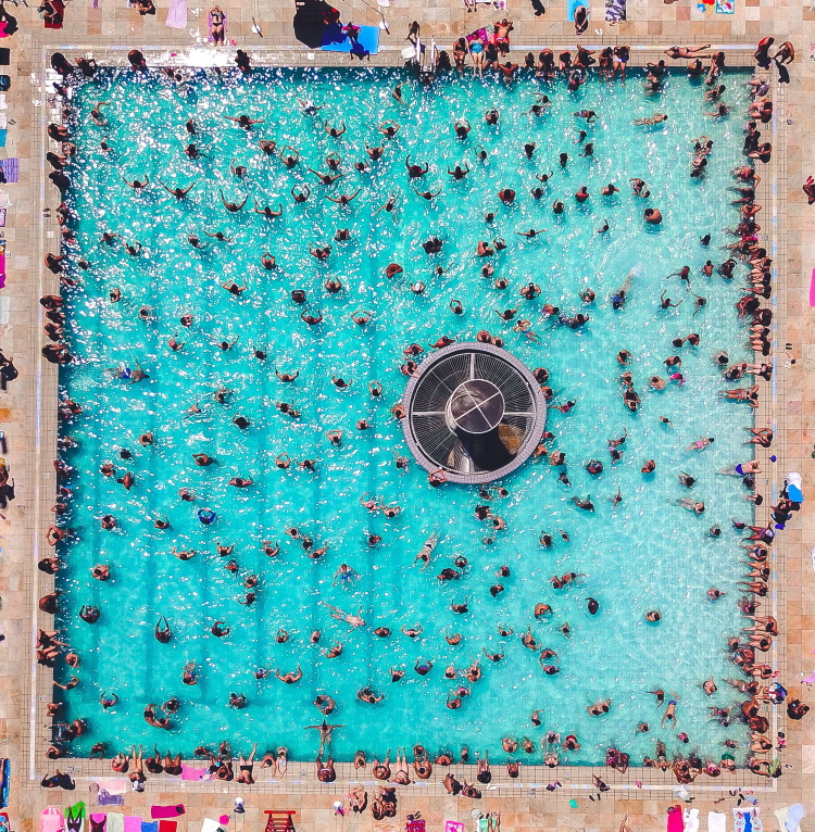 swimming pool packed with swimmers