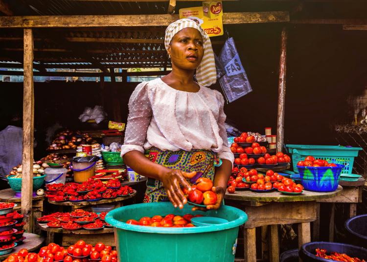 woman selling fresh tomatoes