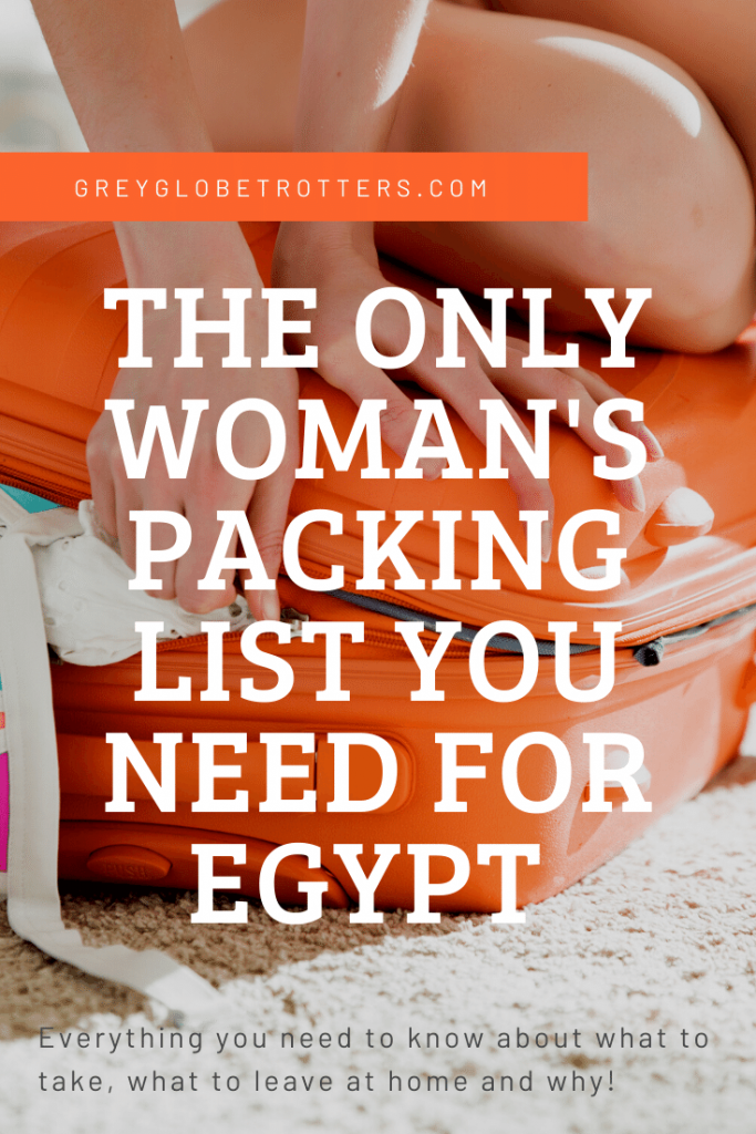 Woman sitting on orange suitcase, trying to force it to close, while reading her packing list for travel to Egypt