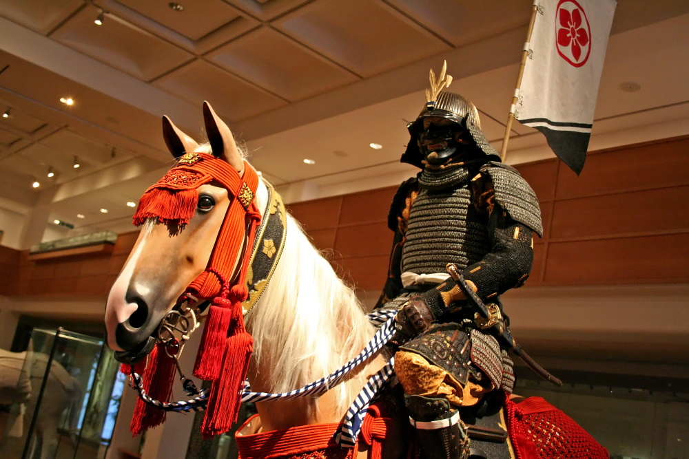 Armed soldier in battle dress on warhorse at Leeds Royal Armouries
