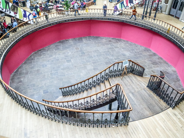 Inside the Leeds Corn Exchange, with circular pit and elaborate staircase