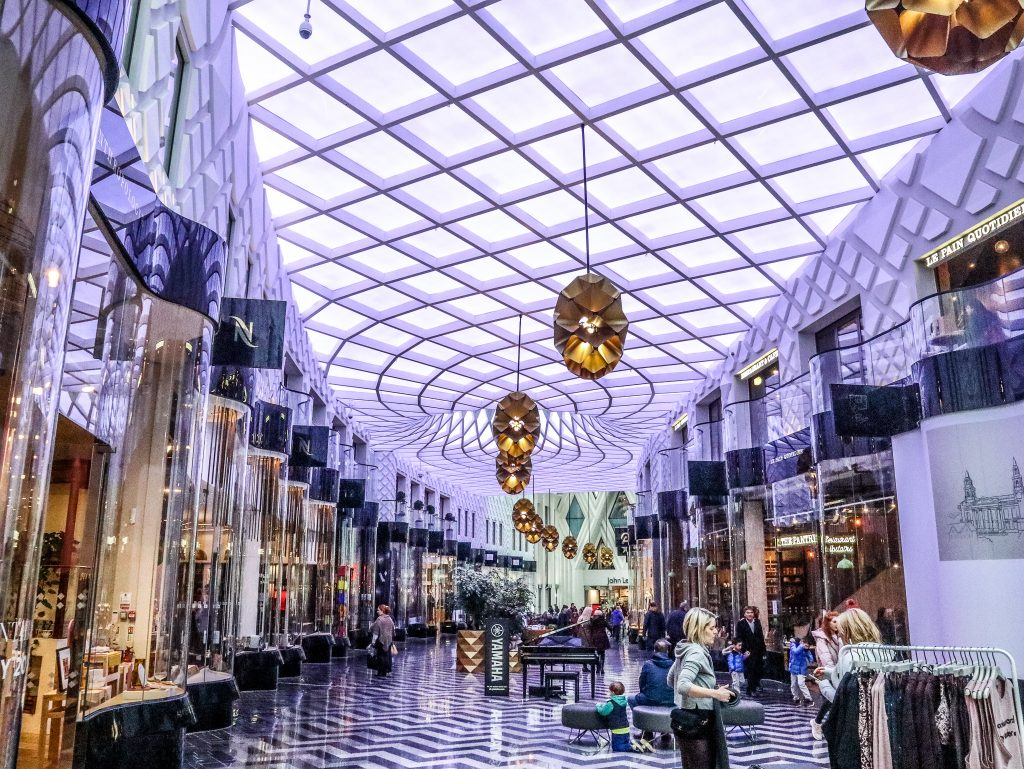 The beautiful tiled interior of Victoria Gate shopping centre, Leeds, with geometric patterned ceiling