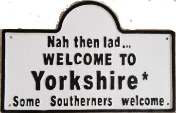 """Funny sign with text """"Nah then lad, Welcome to Yorkshire. Some Southerners welcome"""""""