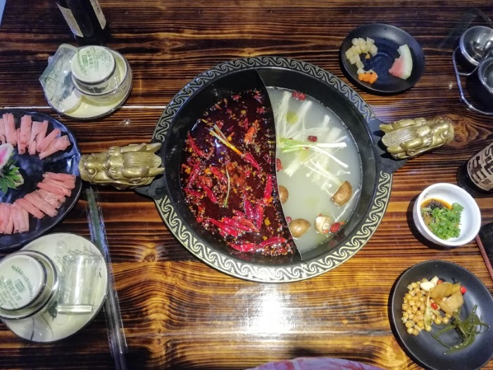 Learn everything you need to know about spicy hotpot in China. Don't make the mistakes I did - learn what the experience is really like!