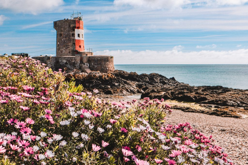 Dominated by an iconic red and white Napoleonic fortress, Archirondel beach is a delight to visit in Jersey