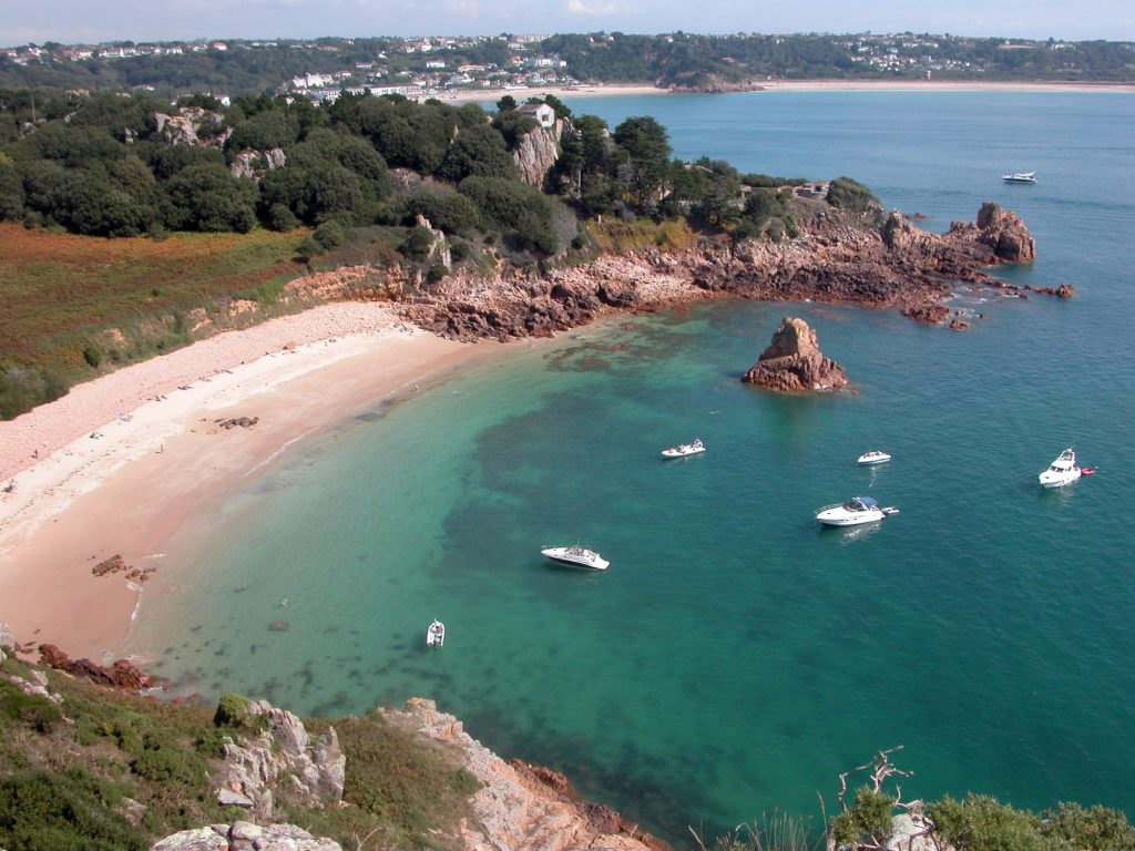Golden sand, pink granite rocks, blue sea and bobbing yachts - it has to be Beauport!