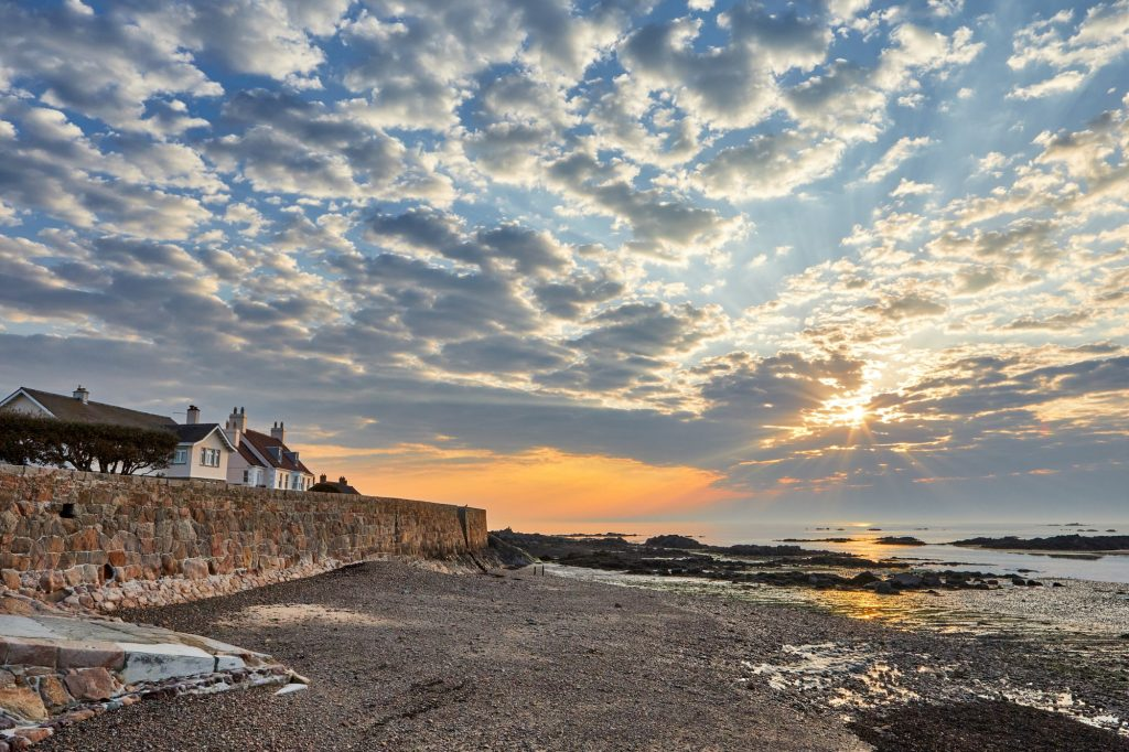 View over La Rocque beach in Jersey at sunrise