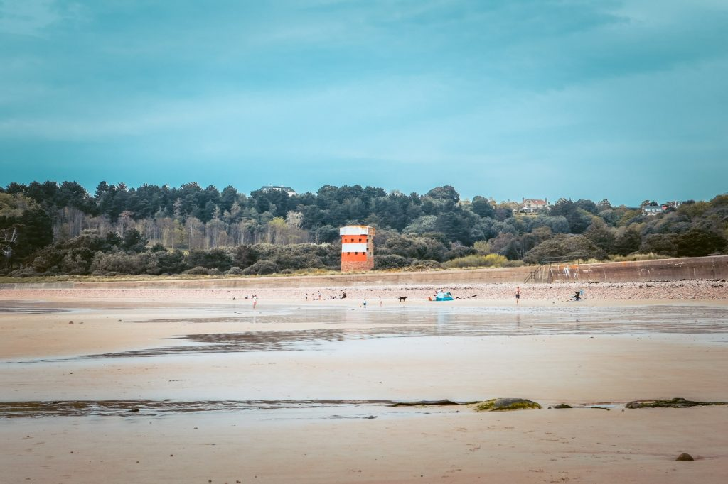 Ouaisne Beach in Jersey with it's landmark Conway Tower painted red and white