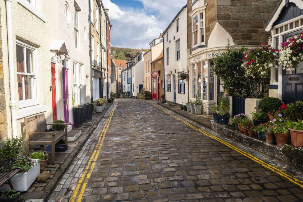The pretty cobbled main street in the old Yorkshire fishing village of Staithes