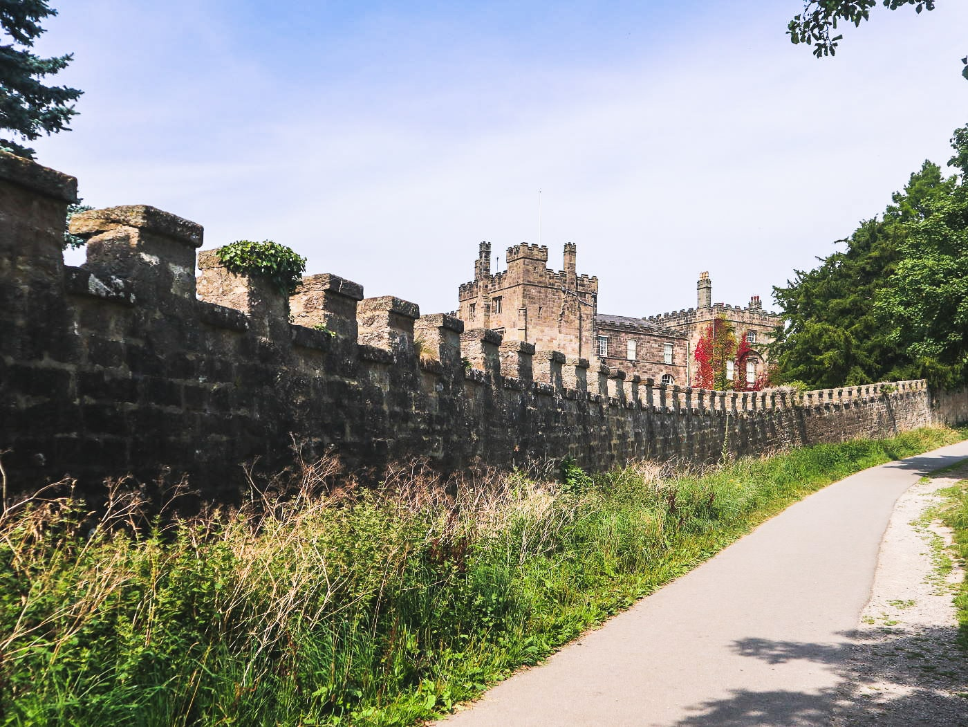 Ripley castle and castle wall from Hollybank lane