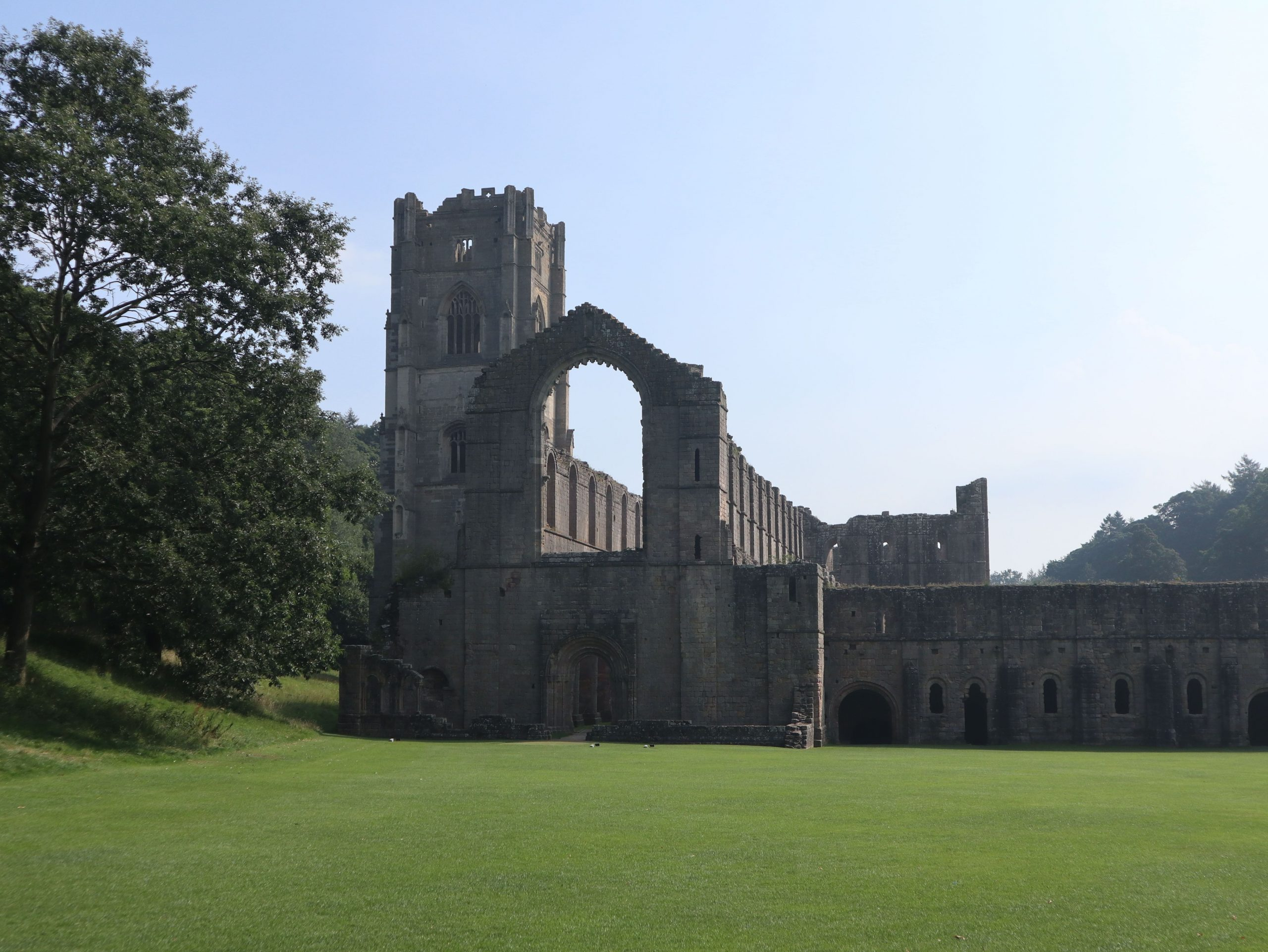 First View of Fountains Abbey Yorkshire min scaled