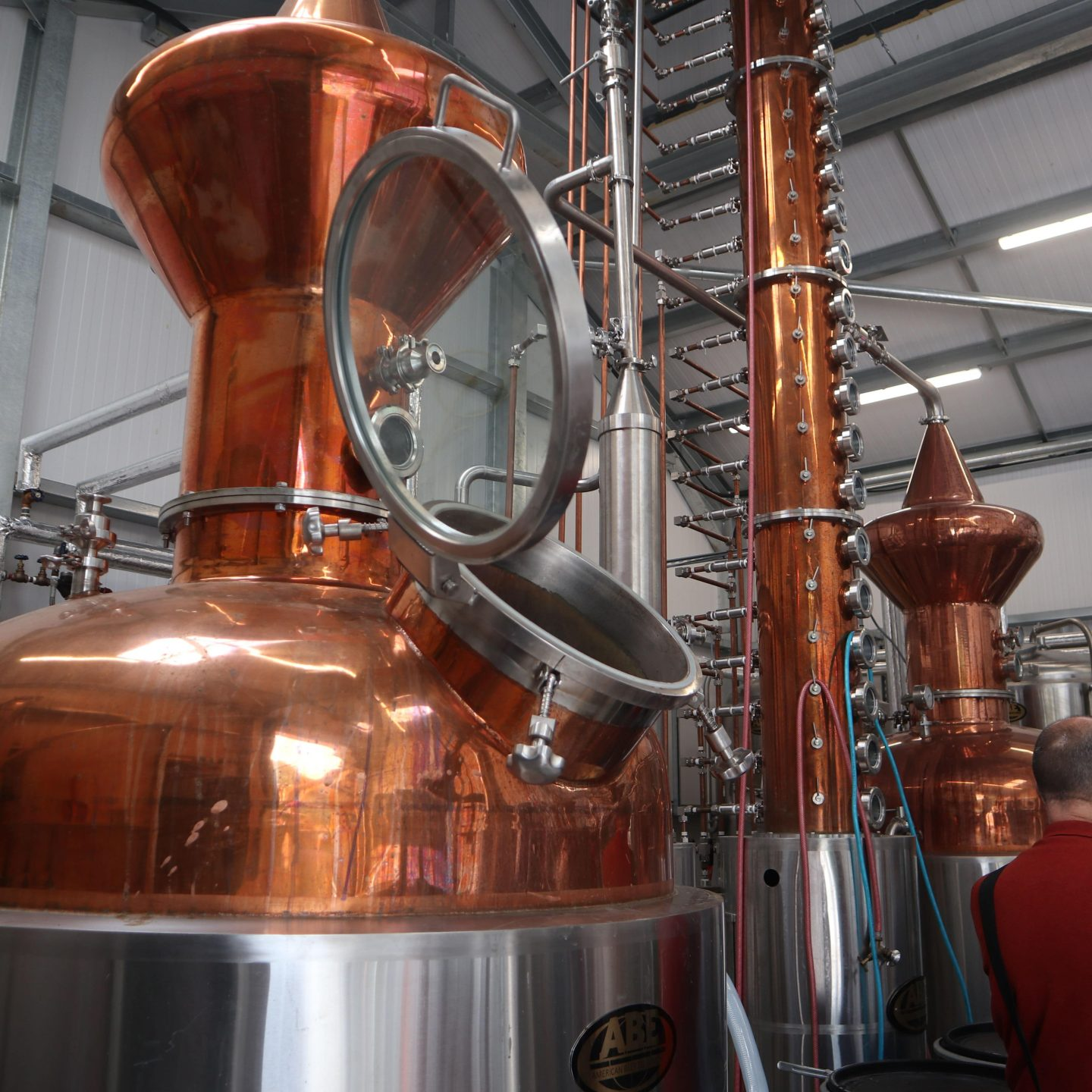 Visiting the shining copper stills on the gin distillery tour at Whittaker's Gin