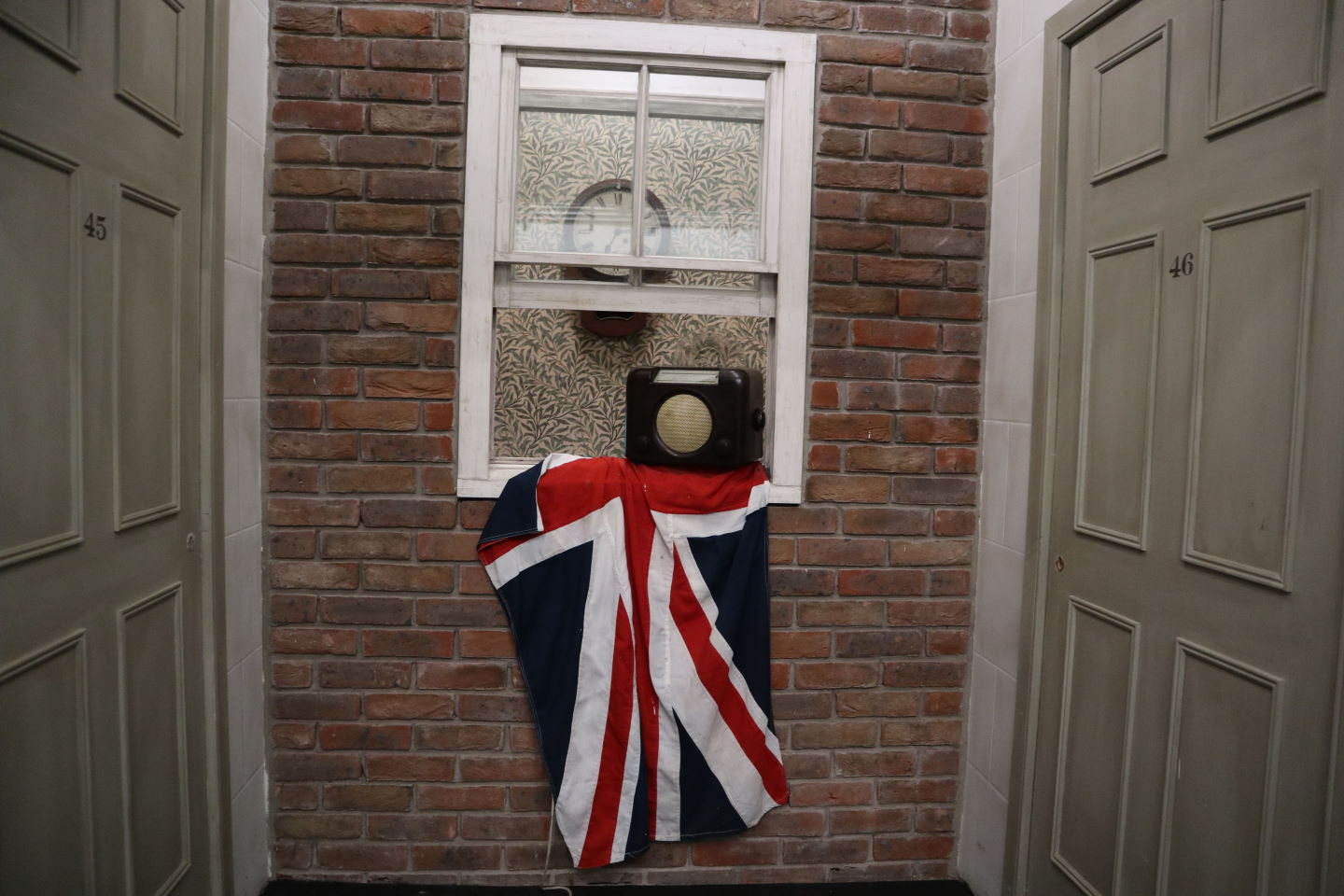 Liberation Day Jersey 1945 Union flag displayed outside the window - War Tunnels Jersey