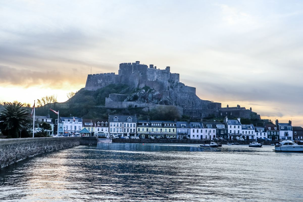 Nestled beneath Mont Orgueil Castle, Gorey Pier is the perfect place for a scenic lunch after using your Jersey Heritage pass at the castle